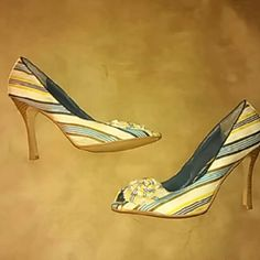 Blue & Yellow Striped Heel Blue and Yellow striped heel with bow at toe opening.  Have been worn quite a bit. Ware marks. Charlotte Russe Shoes Heels