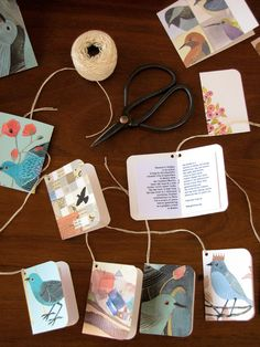 """Using """"scrap"""" printouts of photos and artwork for making little booklets or tags"""