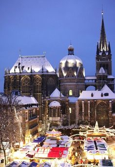 Christmas Market in Aachen around the Aachen Cathedral, the oldest in Northern Europe. Aachen was the capital of the Roman Empire during the reign of Charlemagne.