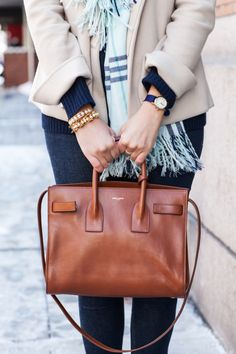 Camel color leather bag / tan and navy outfit with preppy plaid