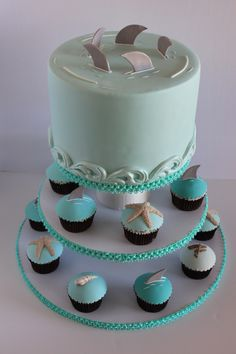 Shark themed baby shower cake with matching cupcakes. Cupcakes have shark fins, star fish, driftwood and sea shells all in varying shades of teal. Baby Shower Cupcakes, Shower Cakes, Baby Shower Parties, Baby Shower Themes, Baby Boy Shower, Shark Birthday Cakes, Shark Cake, Baby Sprinkle, Baby Shark