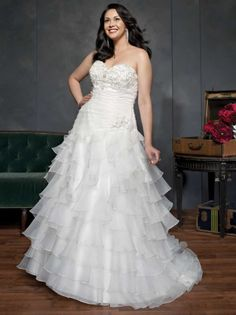 Plus Size Wedding Dresses with Tiered ruffle skirts. Strapless a line wedding dress for the curvy plus size bride. Find more inspirations for plus size wedding dresses here - https://www.dariuscordell.com/featured_item/plus-size-wedding-dresses-bridal-gowns/