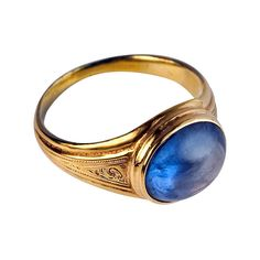 Antique Russian Sapphire Ring in Medieval Style 1860s. A 14K yellow gold ring with engraved decorations is bezel-set with an oval cabochon cut cornflower blue sapphire