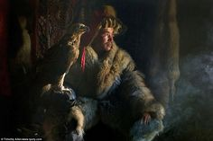 A Mongolian eagle hunter is pictured in this image which was taken with a mobile phone by photographer Timothy Allen
