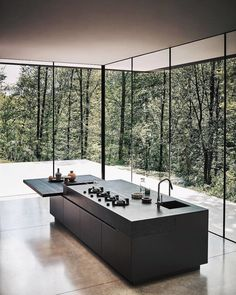 Minimal black kitchen island bench surrounded by tall windows with natural light. - Minimal black kitchen island bench surrounded by tall windows with natural light Modern home House design Source by - Modern Kitchen Design, Modern House Design, Interior Design Kitchen, Home Design, Kitchen Decor, Room Interior, Kitchen Designs, Kitchen Ideas, Diy Kitchen