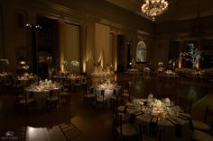 A dim, romantic ambiance is set for this wedding reception at the Hall of Springs. Photo Credit - Matt Ramos Photography