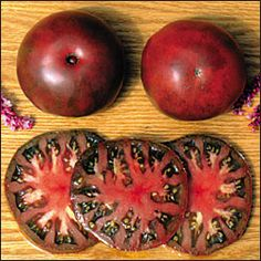 "Black From Tula                   Described by one SSE member as ""the ugliest, most  delicious tomato I've ever grown."" Good yields of  brownish-red slightly flattened globes weighing up  to 14 ounces. Rich full flavor, great for slicing and  canning. Indeterminate, 75-85 days from transplant."