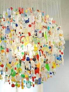 Great Earth Day project. Have all the kids in the school bring one piece of plastic from home to recycle into art. The more colorful the better. #earthday #recylingproject #partyfortheplanet