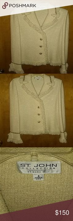 St John's sweater jacket cream color size 4 Beautiful Saint John's cream color sweater jacket with fringe detail and gold buttons size 4. Was worn 2 times. There's a pretty gold Shimmer thread throughout the jacket. Perfect even with a pair of jeans. Bust is 17 in across from armpit to armpit. overall length from top of shoulder to the bottom of Fringe is 25in. Arm length  top of shoulder down is 26 and 1/2 in to the bottom of the Fringe St. John Jackets & Coats