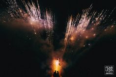 Fireworks displays are fairly commonplace at weddings, and we've all seen images of the bride and groom against a sky full of pyrotechnics. This photographer departed from the expected shot and aligned the couple with the fiery launchpad for the aerial explosions. Showing them in near-silhouette at the heart of the action led to a powerful image.