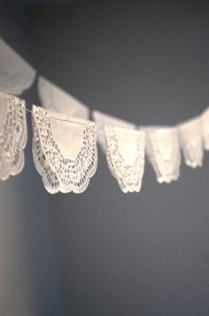doily bunting.... Great idea for a photo back drop... Would be cute for Valentine pictures