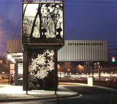 a starbucks built with shipping containers - a cool modern structure!