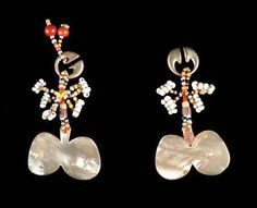 A pair of Kalinga woman's earrings from the Cagayan Valley, Ifugao, Philippines of gold, shell and glass beads. #filipinotattooswomen