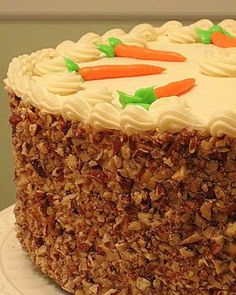 This carrot cake recipe is just plain perfect. It contains everything that we love about carrot cake. It's so yummy and moist and don't forget the cream cheese icing.