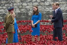 Warm: The Duke and Duchess of Cambridge and Prince Harry attended the Tower of London trib...