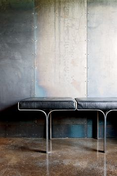 Galvanized-steel walls + concrete floors + aluminum/leather bench