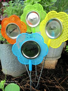 Dollar Store Fly Swatter Plant Labels ~ Kitschy Kitchen Garden Accents http://ourfairfieldhomeandgarden.com/kitschy-kitchen-garden-accents/