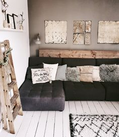 Scandinavian style living room with white wash floorboards, monochrome rug, grey corner sofa and grey feature wall Beige Living Rooms, Living Room White, Boho Living Room, Home And Living, Living Room Decor, Bohemian Living, White Wash Walls, Feature Wall Living Room, Scandinavian Style Home