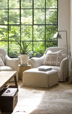 Great conversational area with comfy chairs & ottoman with an Amazing metal paned window with a great view of nature!