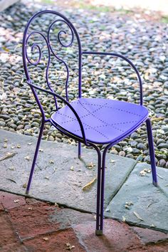 Caprera is a re-interpretation of the classic steel outdoor chair. It has a lilac finish and wonderful detailed design to it.