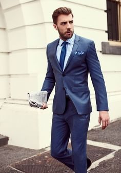 Sleek light navy suit, blue on blue surprisingly go well together