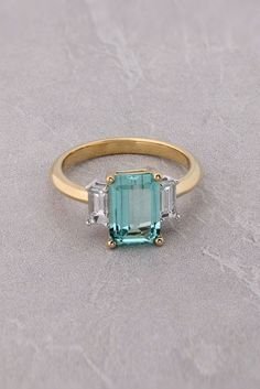 Discover our fine Tourmaline Rectangle and Diamond Ring from Robert Cliff Master Jewellers