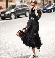 Amazing look - love the skirt and sneakers combination on this stylish street outfit! Its fashion at its best!