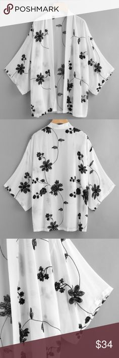 """Floral embroided kimono New. Will fit up to size large. Polyester. White with black embroidery. Measures approx. 22"""" across the chest lying flat, 21"""" across the shoulders and 29"""" long. Tops"""