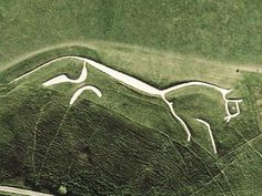 This Bronze Age, 374 feet (110 m) long, 3000 year old, man-made, prehistoric Hill Figure Figure is located in Uffington England. The figure is deeply carved onto the hillside and packed with white chalk. Traditionally the figure was religiously 'scoured' every 7 years by the local community removing all weeds and encroaching vegetation thereby maintaining its pristine silhouette for three eons. It can only be made out from the sky and the reason for its existence is pure speculation.