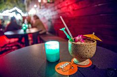 Wednesday, November 2015 After finishing up at Himitsu Lounge in Buckhead, I headed over to Decatur to see the newly opened S., tiki torches light th… Fried Coconut Shrimp, Tiki Lights, Bar Interior Design, How To Make Drinks, Tiki Torches, Hula Girl, Torch Light, Hibiscus Flowers, Served Up