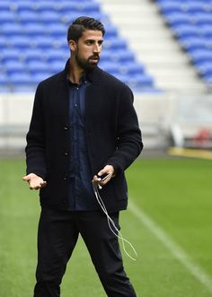 Juventus' German midfielder Sami Khedira walks on the field at the Parc Olympique Lyonnais stadium in Decines-Charpieu near Lyon, southeastern France on Octobre 17, 2016, on the eve of the Champions League football match Olympique Lyonnais against Juventus Football club. / AFP / PHILIPPE DESMAZES