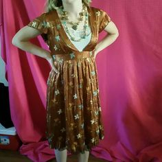 Free People Metallic brown Floral print Free People midi dress. 100% silk like new no rips stains or blemishes never worn. Free People Dresses Midi