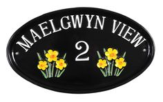 A lovely cast house sign with bright yellow daffodils motif. A lovely spring time sign.