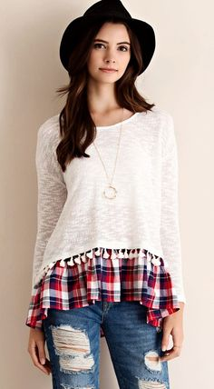 Melange cut&sew slub yarn sweater top featuring checker accent and pom-pom fringed hem detailing. Sheer. Knit. Lightweight. Very sassy boho shirt/ tunic. 50% cotton 50% poly mix.