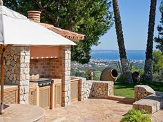 Sea view villa from Son Vida, Mallorca features wonderful barbeque area and outdoor kitchen.