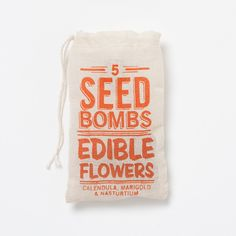 Toss this seed bomb into your landscape, and a forgotten patch of ground becomes a miniature garden for edible flowers including calendula, marigold, and nasturtium. - terrain