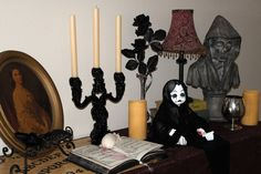 Halloween decorating- This is the table when you enter the house. I love to combine new and old together.