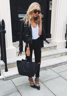 (Faux) leather jackets are my faves! Black and white never goes out of style. So classic, so pretty. Her pointy toed shoes and beautiful purse just top off this look.