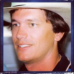 George Strait is HANDSOME!  Look at those green eyes.