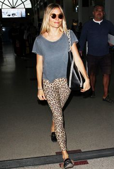 Sienna Miller wearing leopard leggings at the airport.