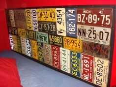 License plate headboard. I like this idea for the boys. cute with a traveler themed room.