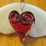 heart pendant made from a tuna can and plastic melt beads from those make-your-own suncatcher kits great summer project must try! :: ecrafty
