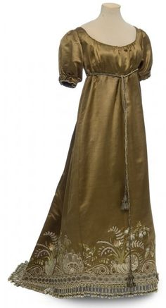 Dress, France, circa 1810. Embroidered satin with tulle and sequins, fringe, and bead trim. Musées des Arts Décoratifs