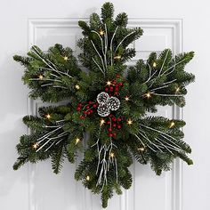 Give a gift as beautiful as fresh snow on Christmas morning. This stunning snowflake wreath is handcrafted with fresh, fragrant Noble Fir and decorated with painted pinecones, red faux berries, and wh Holiday Wreaths, Christmas Decorations, Christmas Ornaments, Homemade Decorations, Christmas Door Wreaths, Halloween Wreaths, Christmas Crafts With Pinecones, Outdoor Xmas Decorations, Halloween Ideas