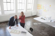 Stock Photo : Two architects discussing project in office