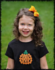 Pumpkin made w/ buttons - awesome idea and great way to save money around holidays, but still look fashionable!