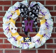 Sorry I left you guys hanging last week with DIY Friday! Sawyer had me so busy I couldn't get it done in time. Let me first apologize t. Big Bows, Cute Bows, Diy Diapers, Diaper Wreath, Wreath Forms, Pirate Theme, Wooden Letters, How To Make Bows, Purple Gold