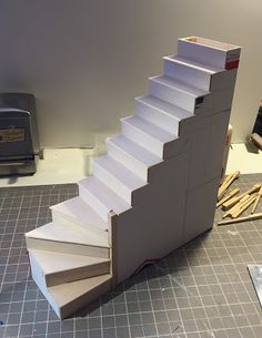 I have finally finished my stairs for the farmhouse and thought I would share the photos. I didnt write directions but it is . Cardboard Dollhouse, Diy Dollhouse, Dollhouse Melanie, Barbie Furniture, Dollhouse Furniture, Dollhouse Staircase, Doll House Crafts, Doll House Plans, House Stairs