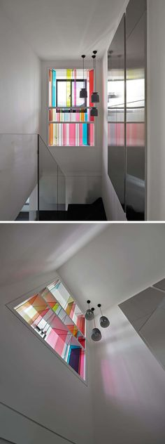 The glass colored windows make this modern white hallway even brighter, with colors dancing on the wall as light hits the glass.