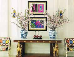 ECLECTIC. ikat chairs, chinese blue and white porcelain. and modern art.